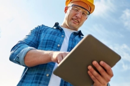 Commercial roofing contractor using tablet to access technical resources