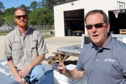 Eric Long and Scott Gayle showing how to use a wet mil gauge