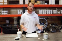 Eric Long demonstrating adhesion properties of different roof coatings
