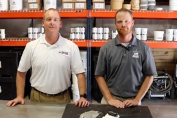 Brian O'Donnell and Eric Long discussing the results of an adhesion test