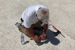 Roof inspector taking a core sample on a foam roof