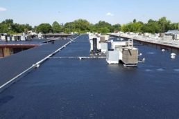 Finished application of asphalt emulsion on built-up roof