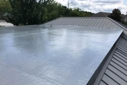 Urethane roof coating over EPDM membrane