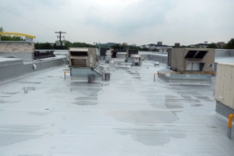 Urethane roof coating on rooftop of popular chain restaurant