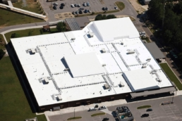 Aerial view of the Envir-O-Sil flat roof coating system on a high school building