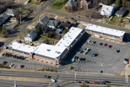Aerial view of strip mall with Ure-A-Sil flat roof coating system installed