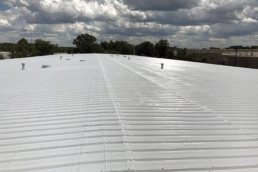 Metal roof with silicone coating system installed