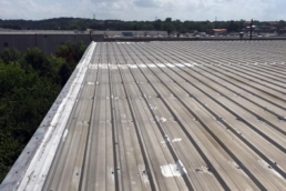 Metal roof affected by areas of rust and corrosion