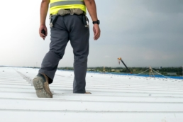 Contractor conducting roof maintenance