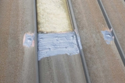 Urethane roof mastic on standing seam metal roof