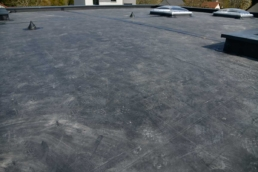 Aged EPDM material on flat roof