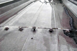 Loose fasteners on an old metal roof