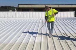 Top coat application of metal roof restoration