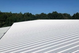 Roof coating system on large corrugated metal roof