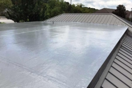 Silver roof coating on flat EPDM roof