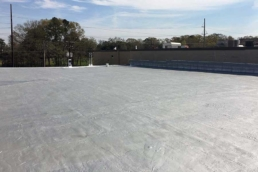 Silver roof coating on commercial flat roof