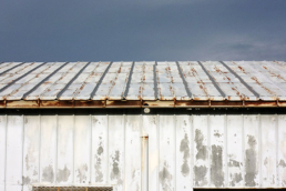 Rust and paint on commercial metal roof