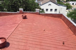 Rust inhibiting primer on a commercial metal roof