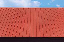Rust inhibitor primer on commercial metal roof