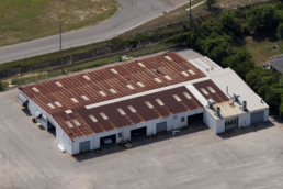 Commercial metal roof with heavy amount of rust