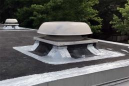 Polyurethane roof mastic applied around EPDM roof ventilation