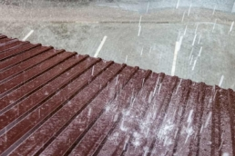 Heavy rainfall on commercial metal roof