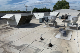 Fast food restaurant leaking base roof with HVAC equipment