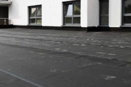 EPDM flat roofing membrane on condominium building