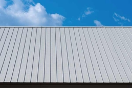 Sloped standing seam metal roof