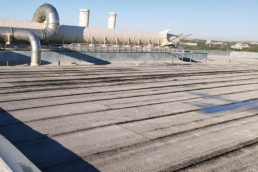 Modified bitumen roofing system on large industrial manufacturing building