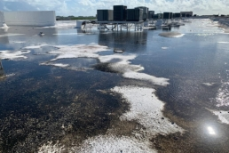 Ponding water and acrylic debris on SPF roof