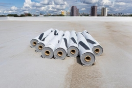 Rolls of PVC material on large commercial roof