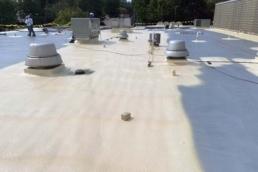 Newly installed SPF on a commercial flat roof