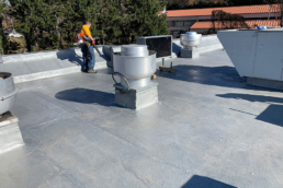 Urethane base coat applied on fast food industry roof