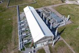 Aerial view of industrial building with acrylic-coated metal roof