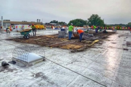 Commercial roofers working on large flat roof