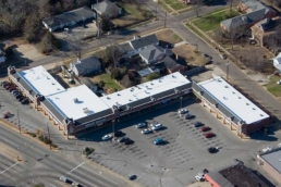 Aerial view of strip mall with silicone-coated flat roof