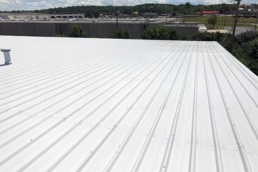 Silicone roof coatings on commercial metal roof