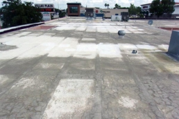 Dirt accumulation on silicone-coated commercial flat roof