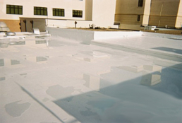 Ponding water on silicone-coated flat roof surface