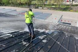 Metal roof pressure washing