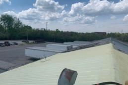 Spray polyurethane foam over metal roof