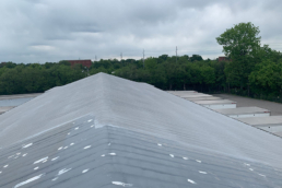 Silicone 412 base coat over SPF metal roof