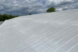 Silicone 412 top coat over SPF metal roof