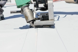 Robot welder welding seams on TPO roof