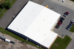 Aerial view of low-slope TPO roof