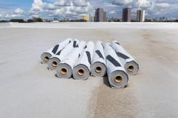 Rolls of PVC membrane on flat roof