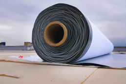 Roll of TPO membrane sitting on roof