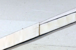 Tapered polyiso roofing insulation