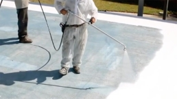 Silicone roof coating being spray-applied to various roof types